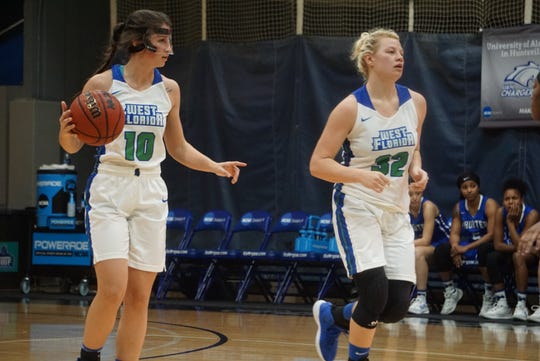 UWF senior point guard Anna Hall (left) dribbles up the court with forward Halee Nieman (right) against Shorter on Jan. 17, 2019. Hall and Nieman are both transfers from Saginaw Valley State.
