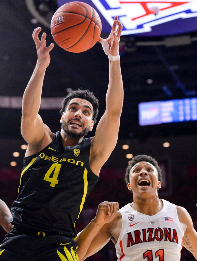 Jan 17, 2019; Tucson, AZ, USA; Oregon Ducks guard Ehab Amin (4) goes after the ball in front of Arizona Wildcats forward Ira Lee (11) at McKale Center. Mandatory Credit: Casey Sapio-USA TODAY Sports