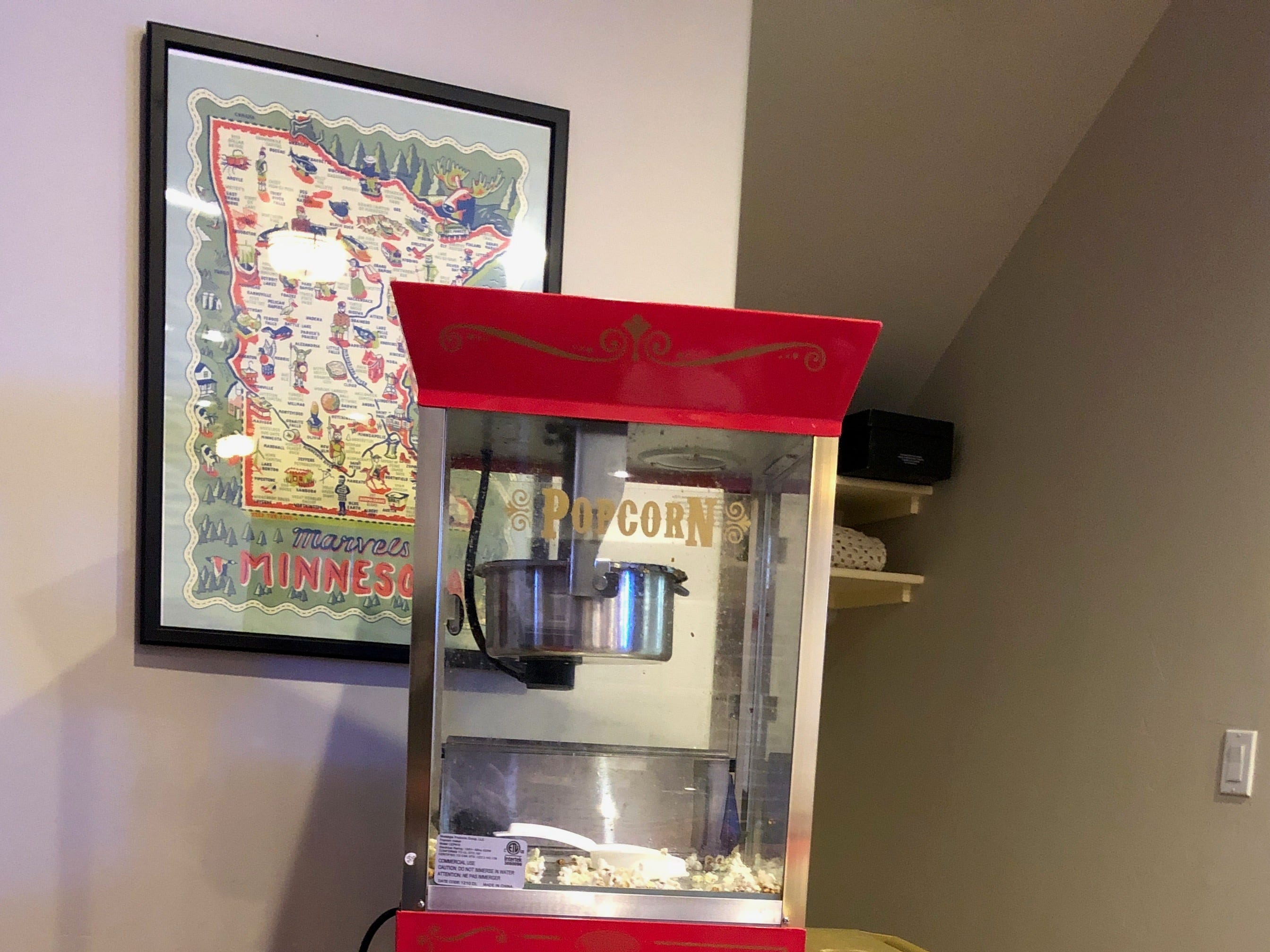 An old-fashioned popcorn machine is one of the fun amenities in the basement, which has been turned into a game and recreation room.