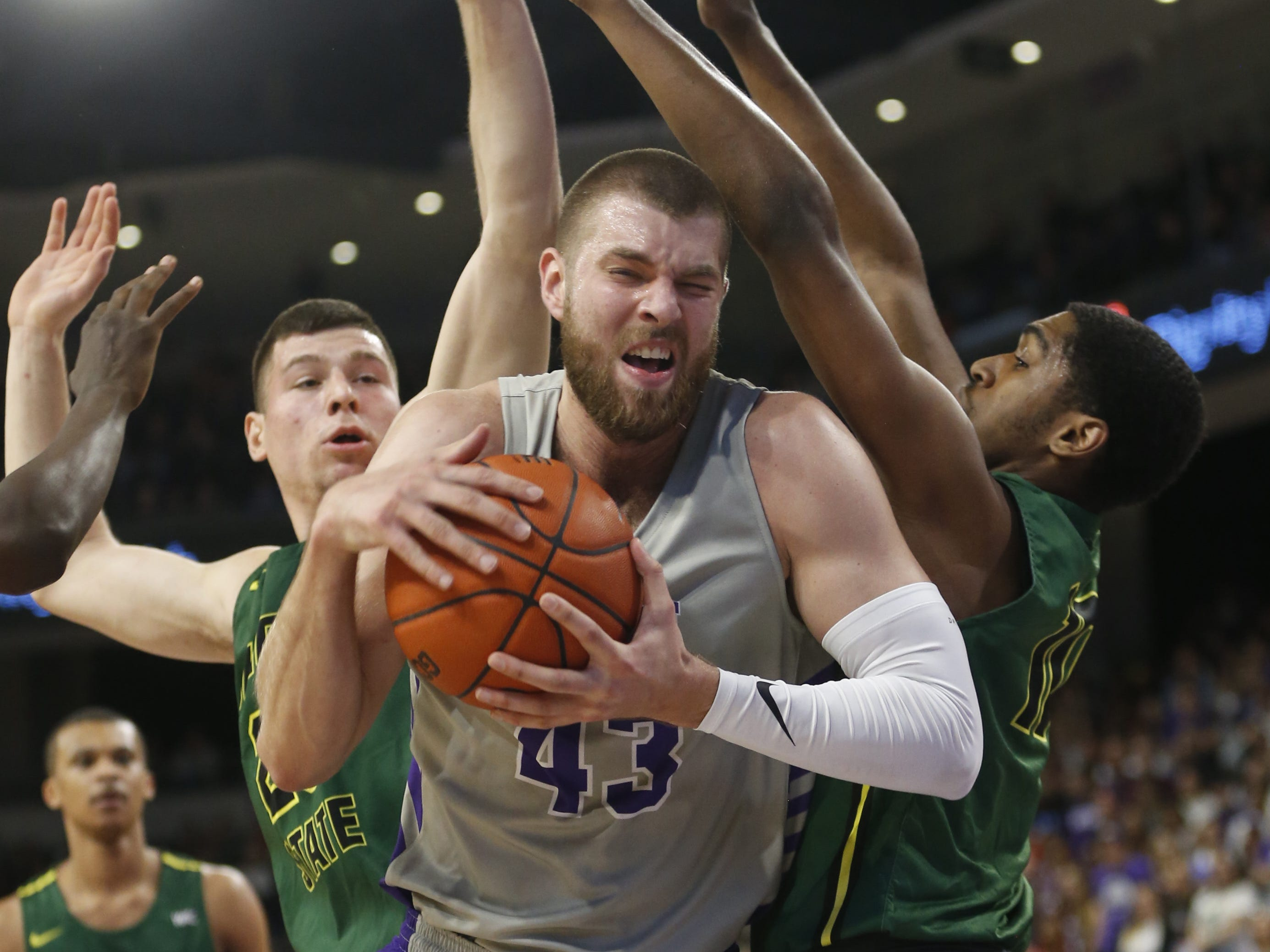 GCU's Michael Finke (43) grabs a rebound against Chicago State University's Anthony Harris (10) during the first half at Grand Canyon University Arena in Phoenix, Ariz. on January 17, 2019.
