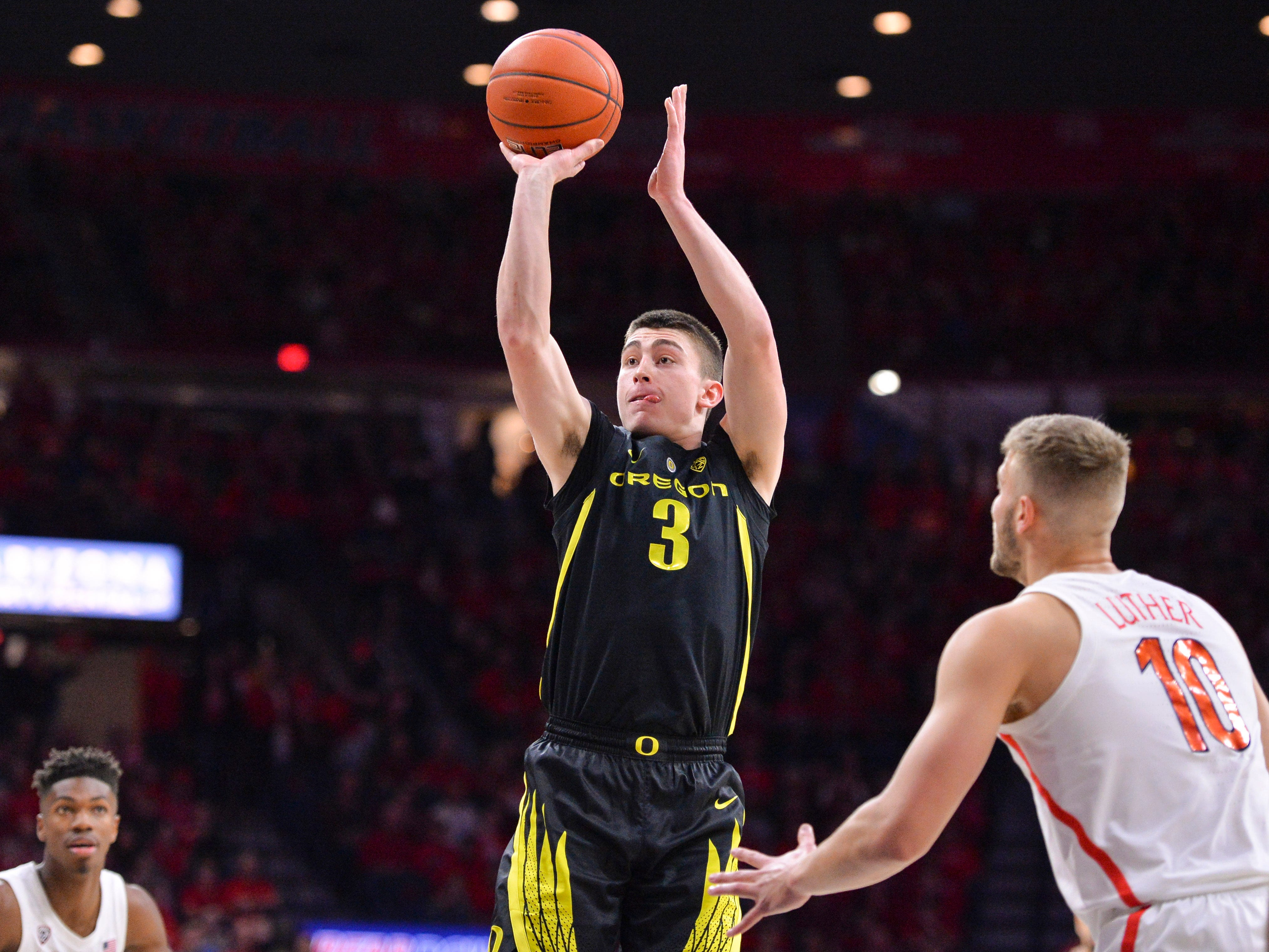 Jan 17, 2019; Tucson, AZ, USA; Oregon Ducks guard Payton Pritchard (3) shoots the ball as Arizona Wildcats forward Ryan Luther (10) defends during the first half at McKale Center. Mandatory Credit: Casey Sapio-USA TODAY Sports