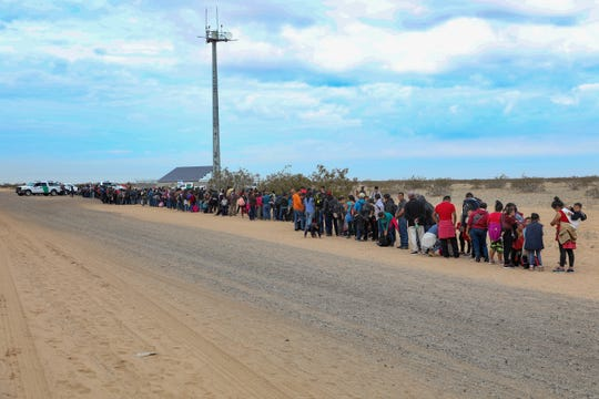 A group of 376 mostly Guatemalan families and minors wait for Border Patrol agents to process them on Jan. 14, after they tunneled under the border fence near the San Luis port of entry.
