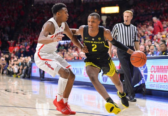 Jan 17, 2019; Tucson, AZ, USA; Oregon Ducks forward Louis King (2) dribble the ball as Arizona Wildcats guard Brandon Williams (2) defends during the first half at McKale Center. Mandatory Credit: Casey Sapio-USA TODAY Sports