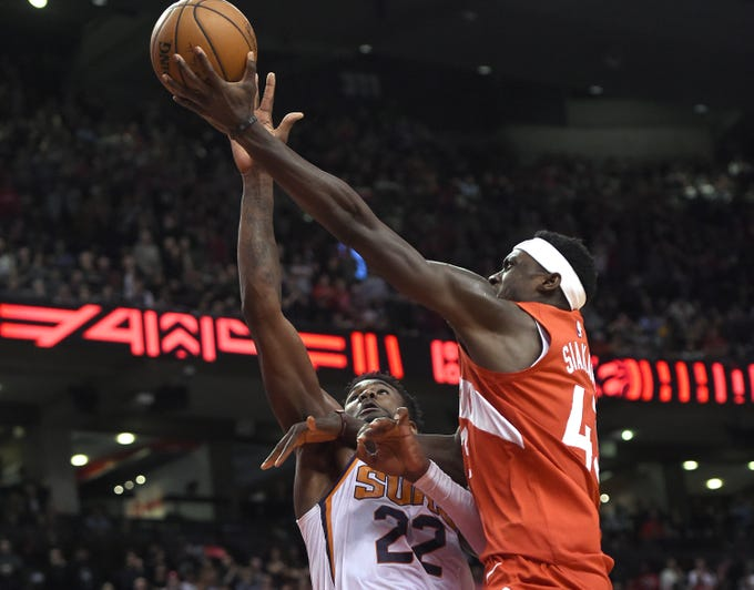 Jan 17, 2019; Toronto, Ontario, CAN; Toronto Raptors forward Pascal Siakam (43) scores the winning basket at the final buzzer over Phoenix Suns center Deandre Ayton (22) in the second half at Scotiabank Arena. Mandatory Credit: Dan Hamilton-USA TODAY Sports