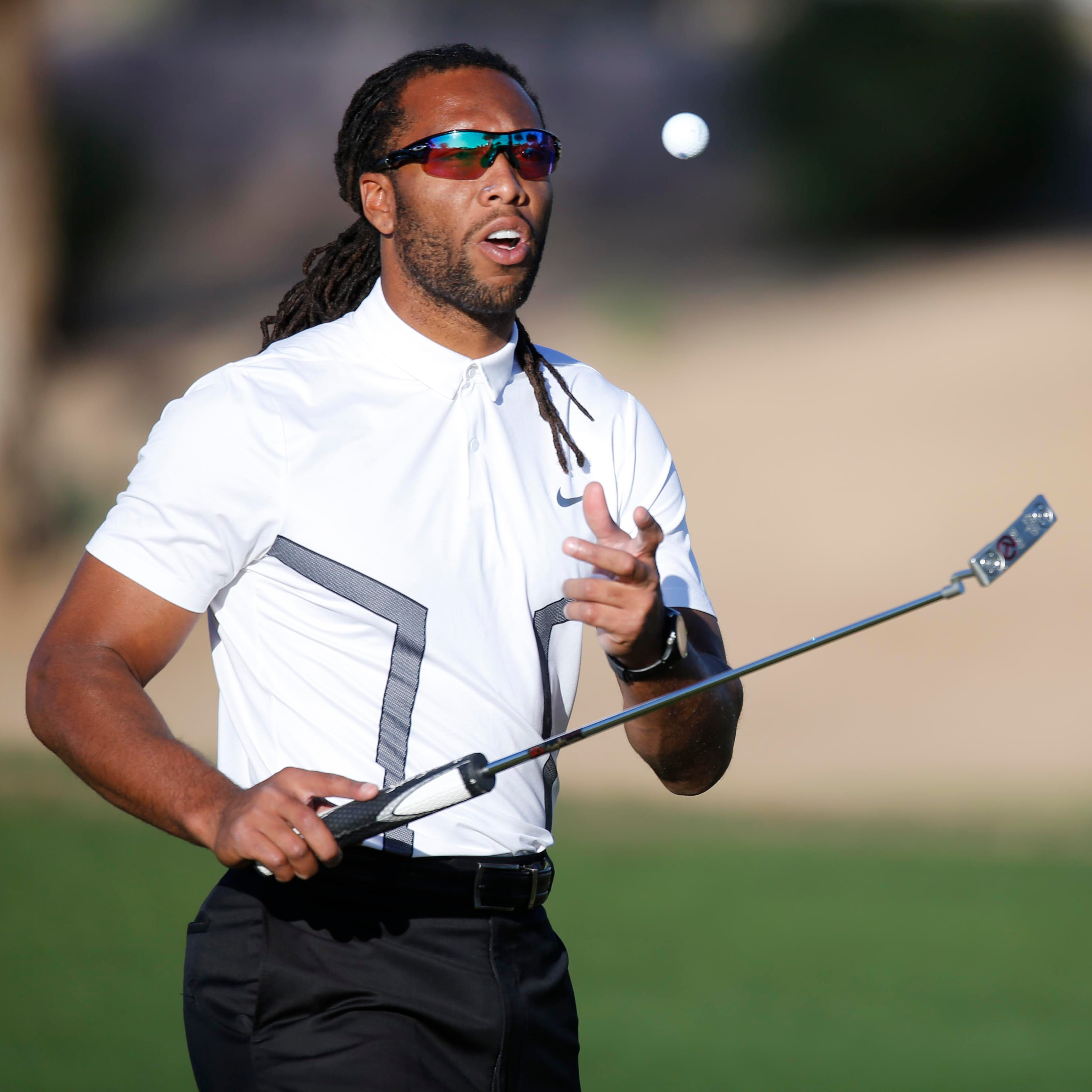 Cardinals' Larry Fitzgerald makes hole in one playing with Barack Obama