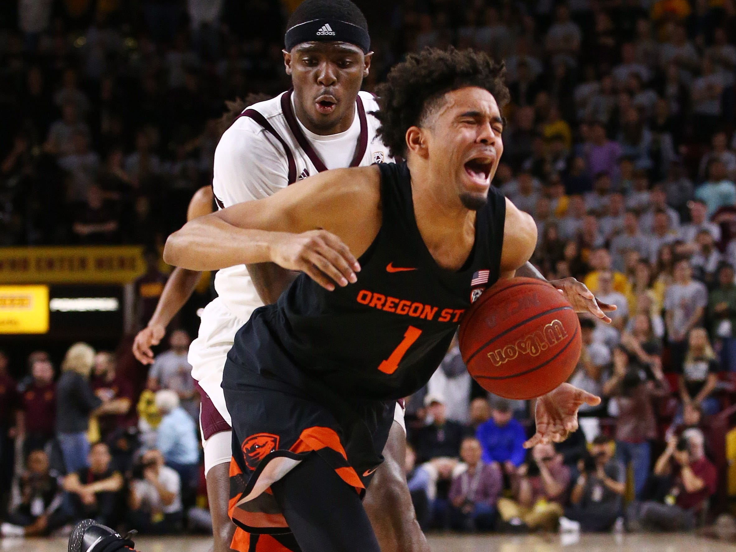 Oregon State Beavers guard Stephen Thompson Jr. is guarded by Arizona State Sun Devils' Zylan Cheatham in the first half on Jan. 17 at Wells Fargo Arena in Tempe.