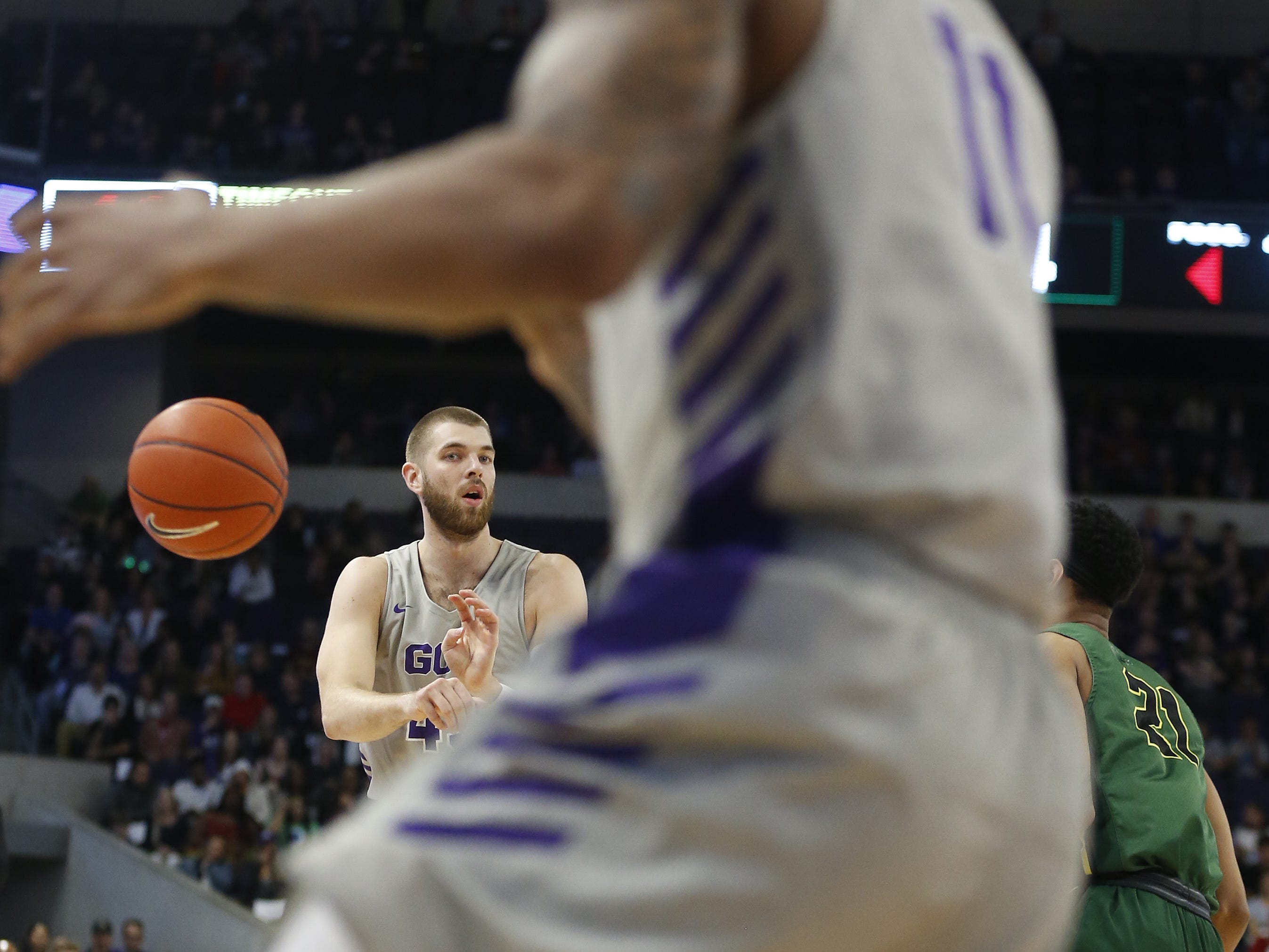 GCU's Michael Finke (43) passes to teammate Damari Milstead (11) against Chicago State University during the first half at Grand Canyon University Arena in Phoenix, Ariz. on January 17, 2019.