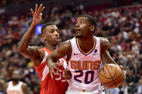 Phoenix Suns forward Josh Jackson (20) controls the ball as Toronto Raptors guard Delon Wright (55) defends during the second half of an NBA basketball game Thursday, Jan. 17, 2019, in Toronto. (Frank Gunn/The Canadian Press via AP)