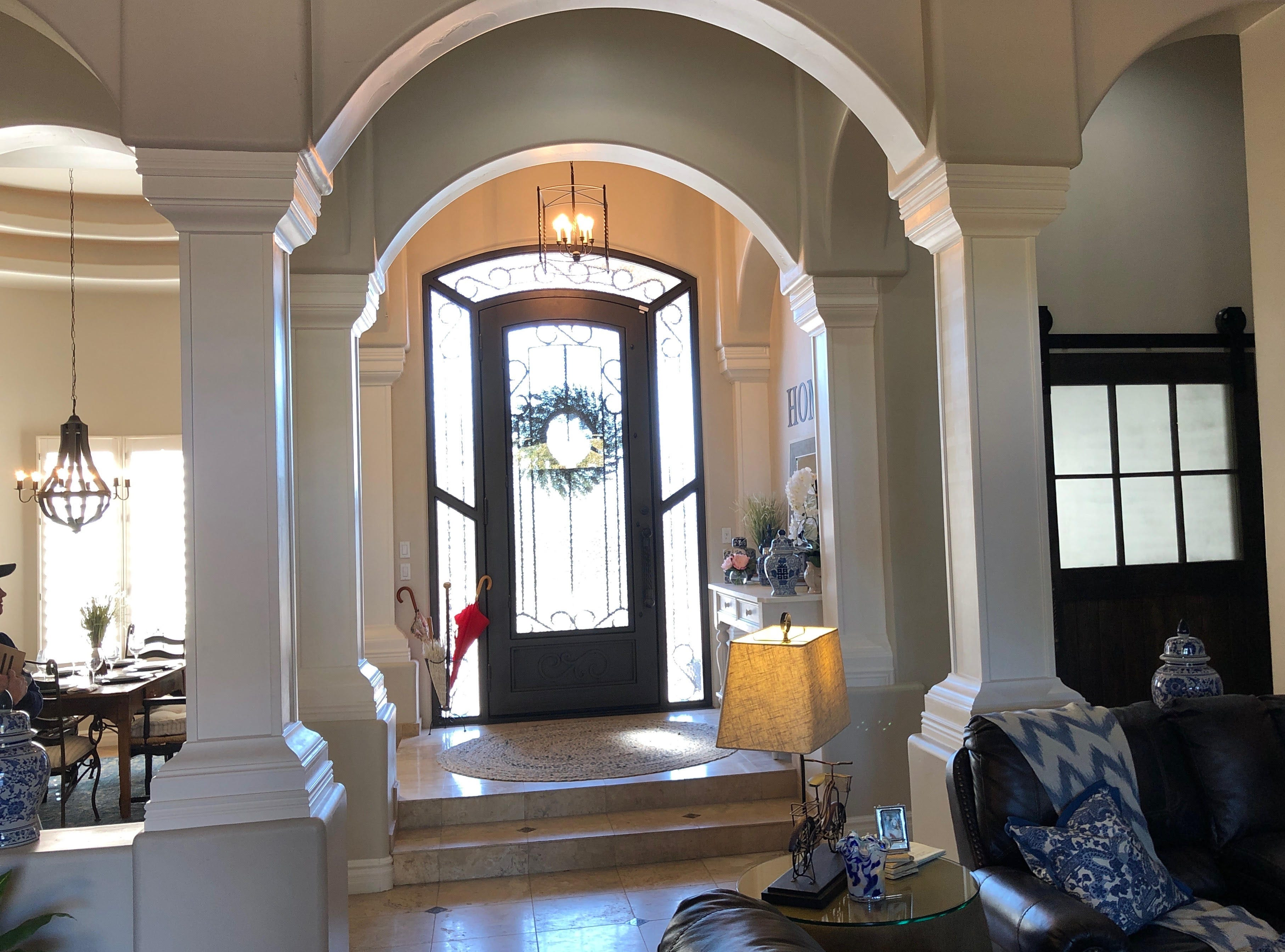 What used to be an open space to the right of the front door was walled off to create Todd's office. Rounded pillars the resemble the ones near the front door were replaced with square wood columns to give the space and updated look.