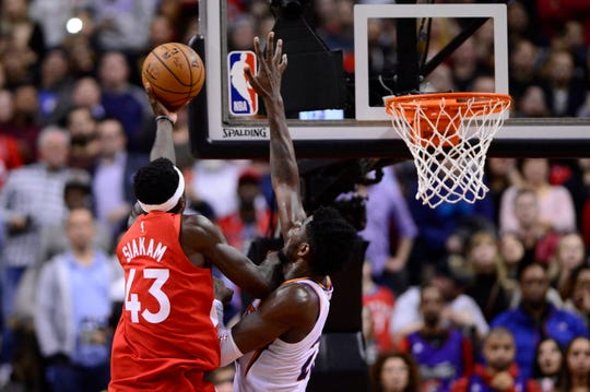 Toronto Raptors forward Pascal Siakam (43) scores the game-winning basket over Phoenix Suns center Deandre Ayton (22) during an NBA basketball game Thursday, Jan. 17, 2019, in Toronto. (Frank Gunn/The Canadian Press via AP)