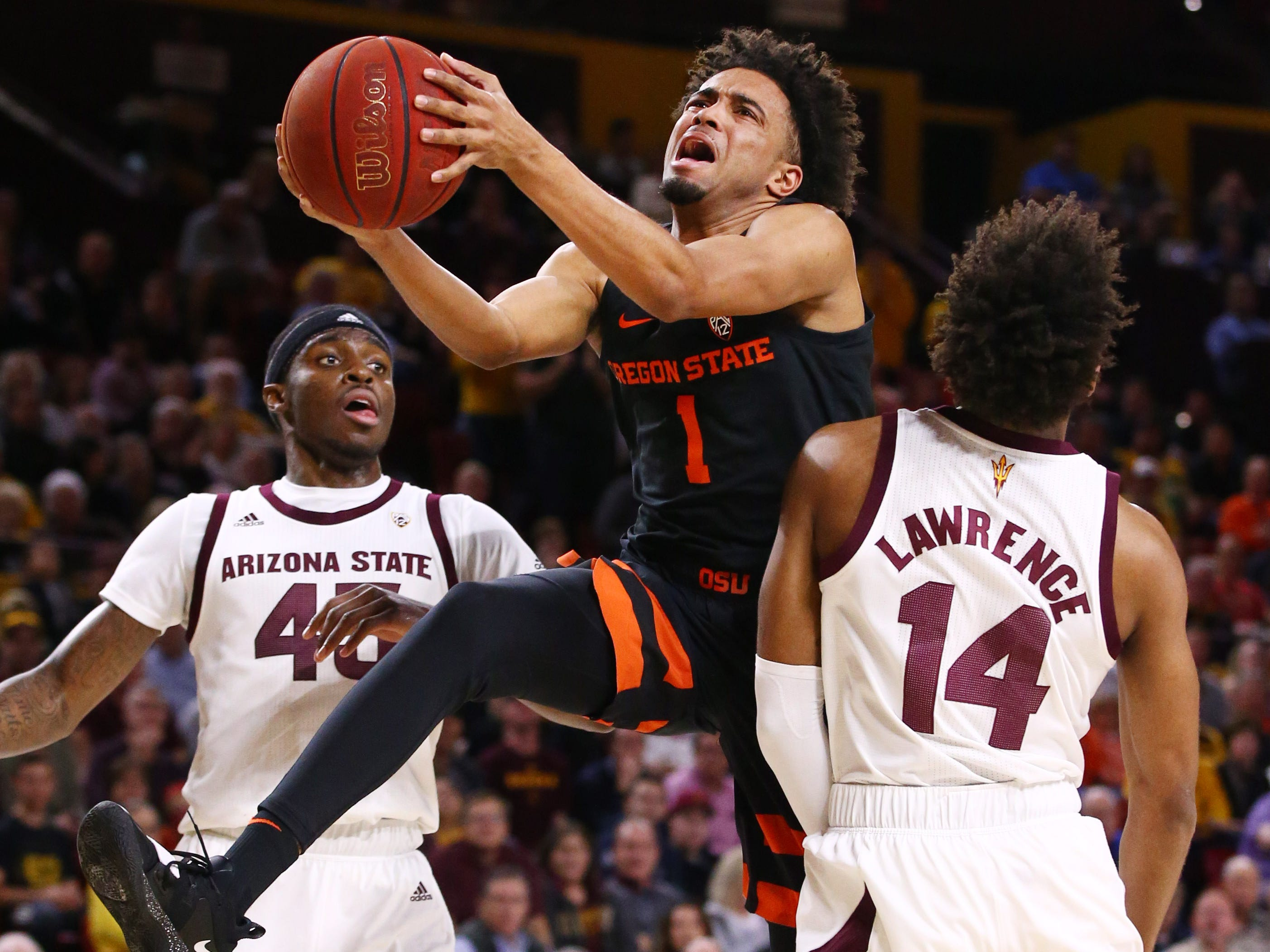 Oregon State Beavers guard Stephen Thompson Jr. is fouled by Arizona State Sun Devils' Kimani Lawrence in the first half on Jan. 17 at Wells Fargo Arena in Tempe.