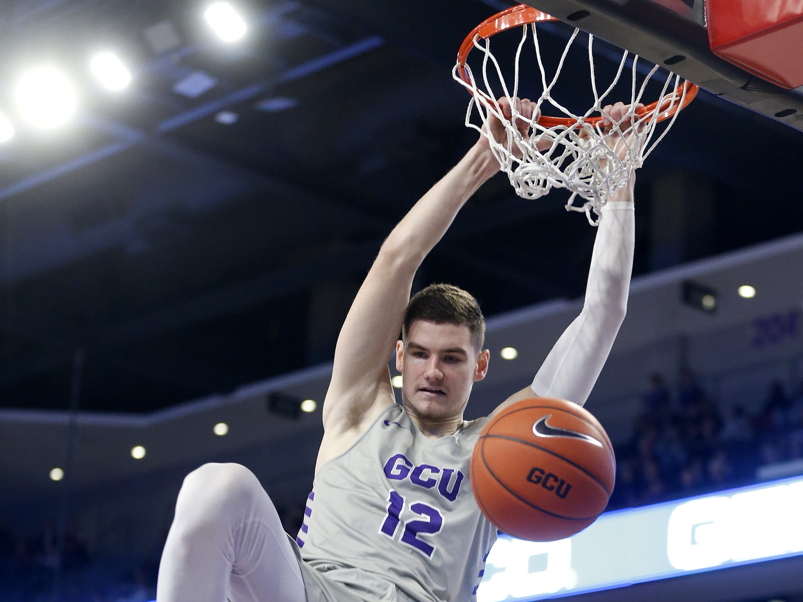 GCU's Roberts Blumbergs (12) dunks against Chicago State University during the first half at Grand Canyon University Arena in Phoenix, Ariz. on January 17, 2019.