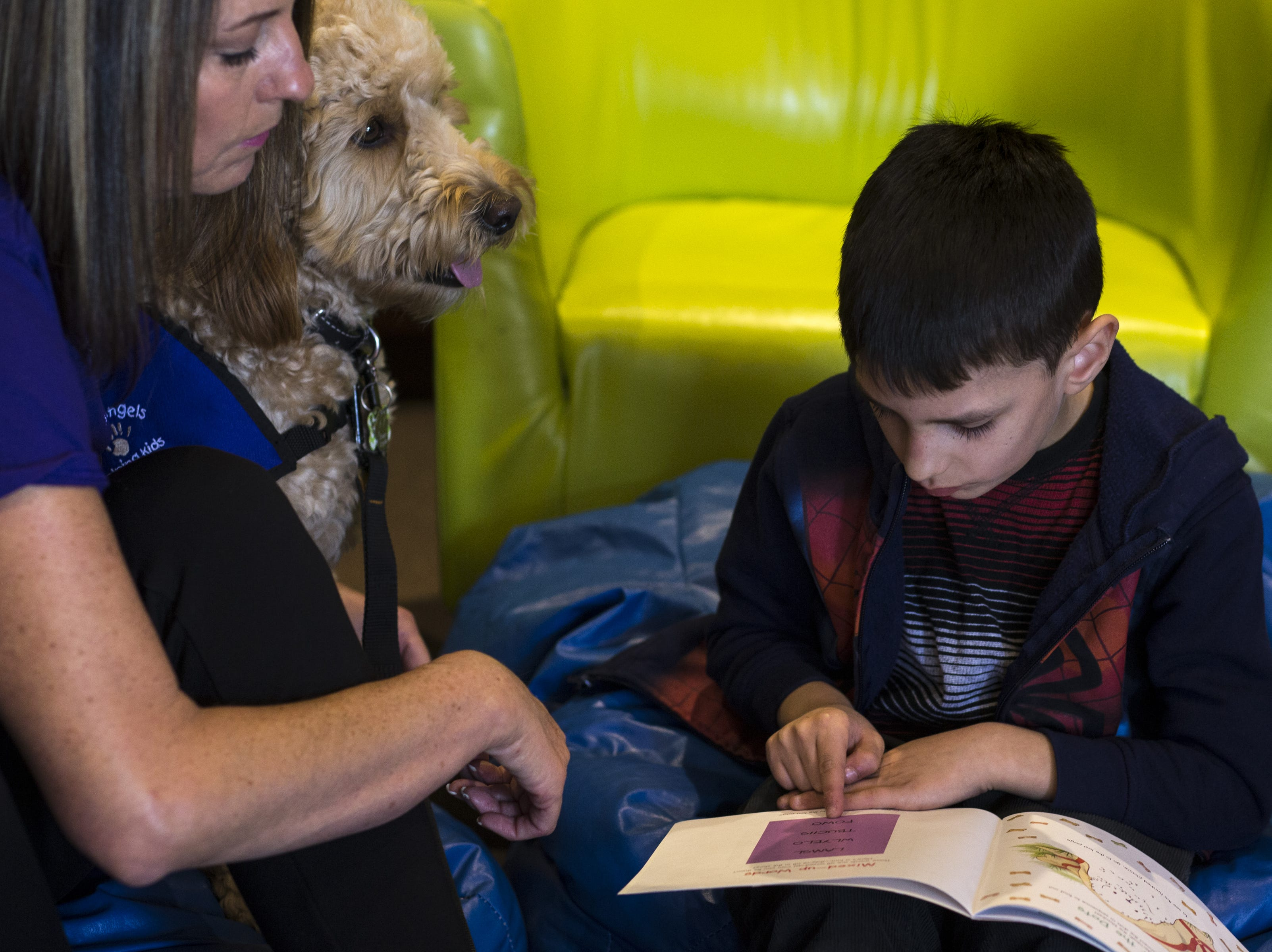 Zane reads with Caymus and Michelle Newlin of Gabriel's Angels, Jan. 7, 2019, at Aurora Day School in Peoria.