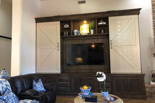 Barn doors were used to hide and reveal the TV in theentertainment center.