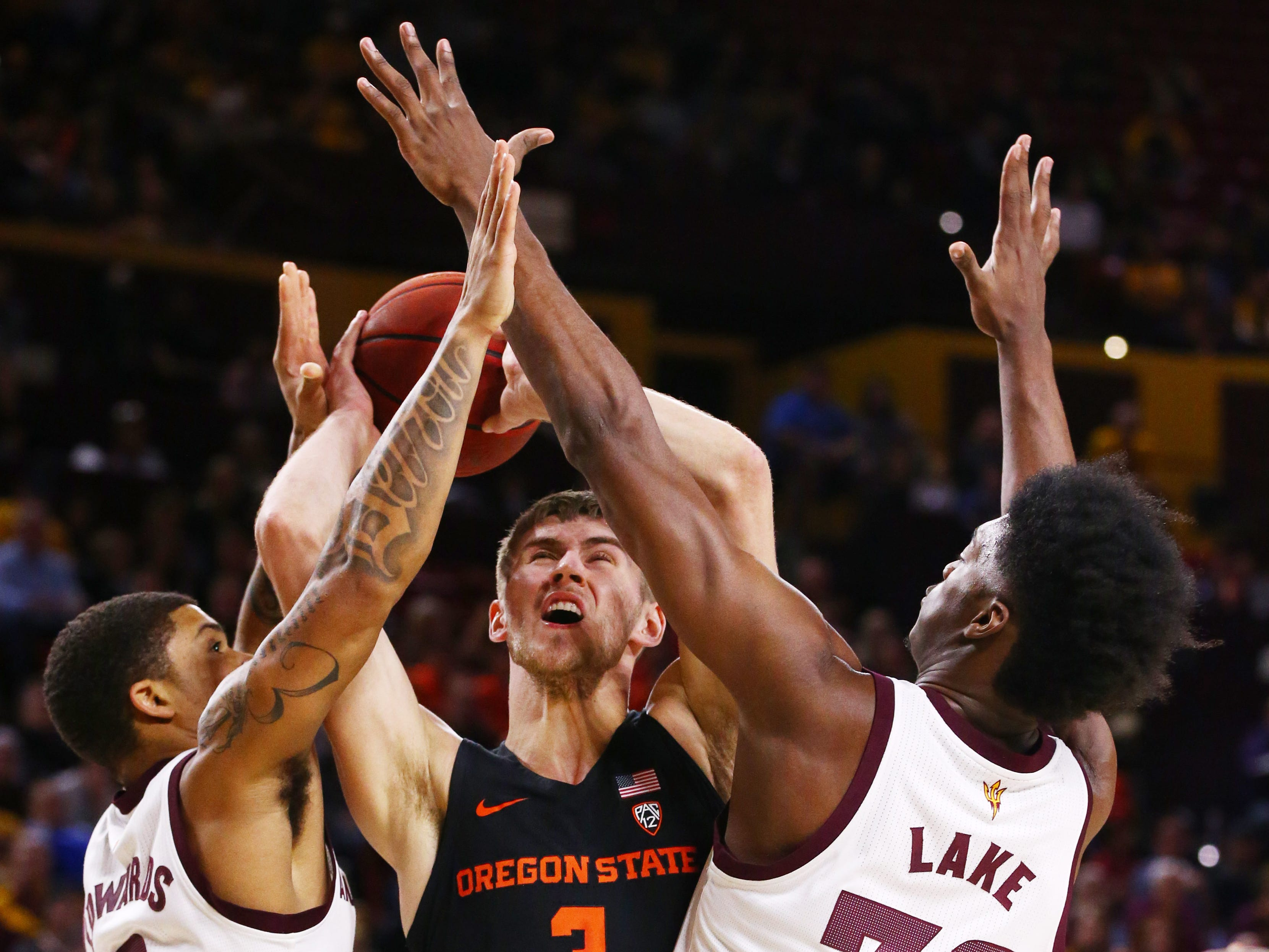 Arizona State Sun Devils Rob Edwards and De'Quon Lake pressure Oregon State Beavers forward Tres Tinkle in the first half on Jan. 17 at Wells Fargo Arena in Tempe.