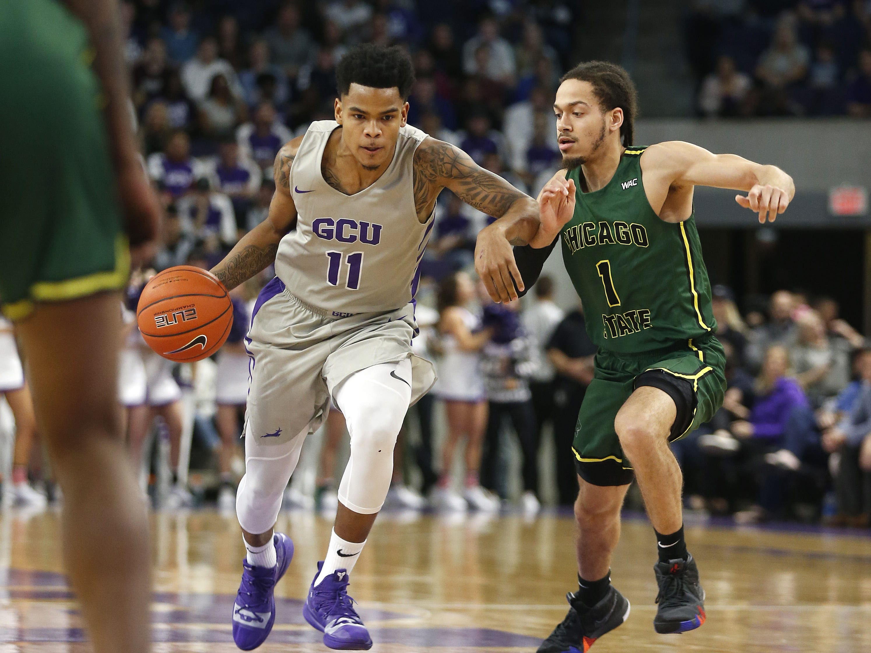 GCU's Damari Milstead (11) drives against Chicago State University's Rob Shaw (1) during the first half at Grand Canyon University Arena in Phoenix, Ariz. on January 17, 2019.