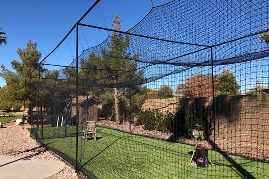 Owning a house with a backyard large enough to accommodate a batting cage was on the Revenigs' wish list. Theirs includes a pitching machine and turf from which Holly's brother Mike Alexander, who owns Artificial Grass Superstore. The surface is the same at Sloan Park, the Chicago Cubs spring training ballpark.