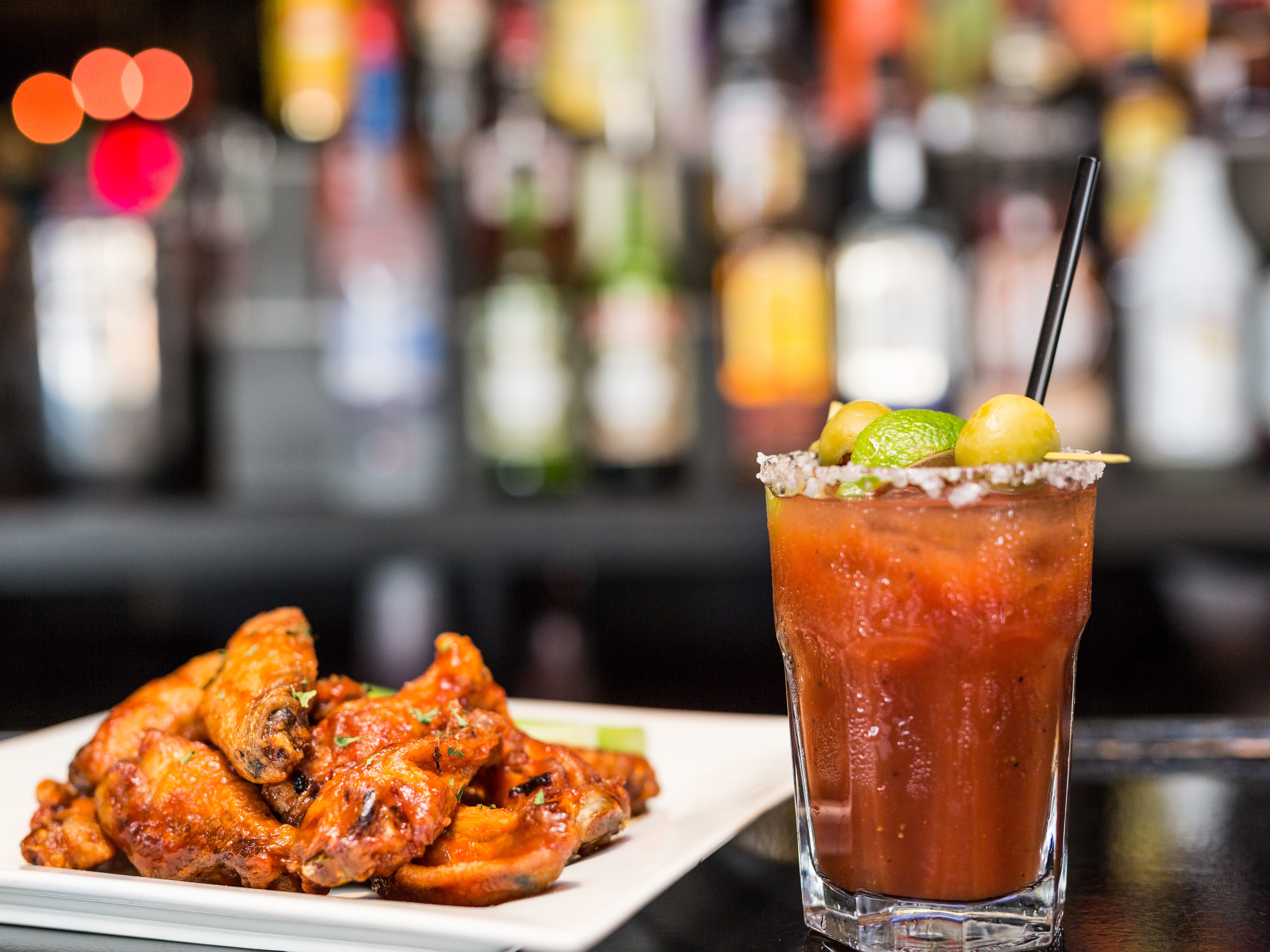 Wings and a bloody Mary at Half Moon Sports Grill.