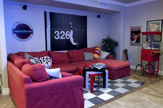 Plenty of plushy seating welcomes movie viewers and video game players.
