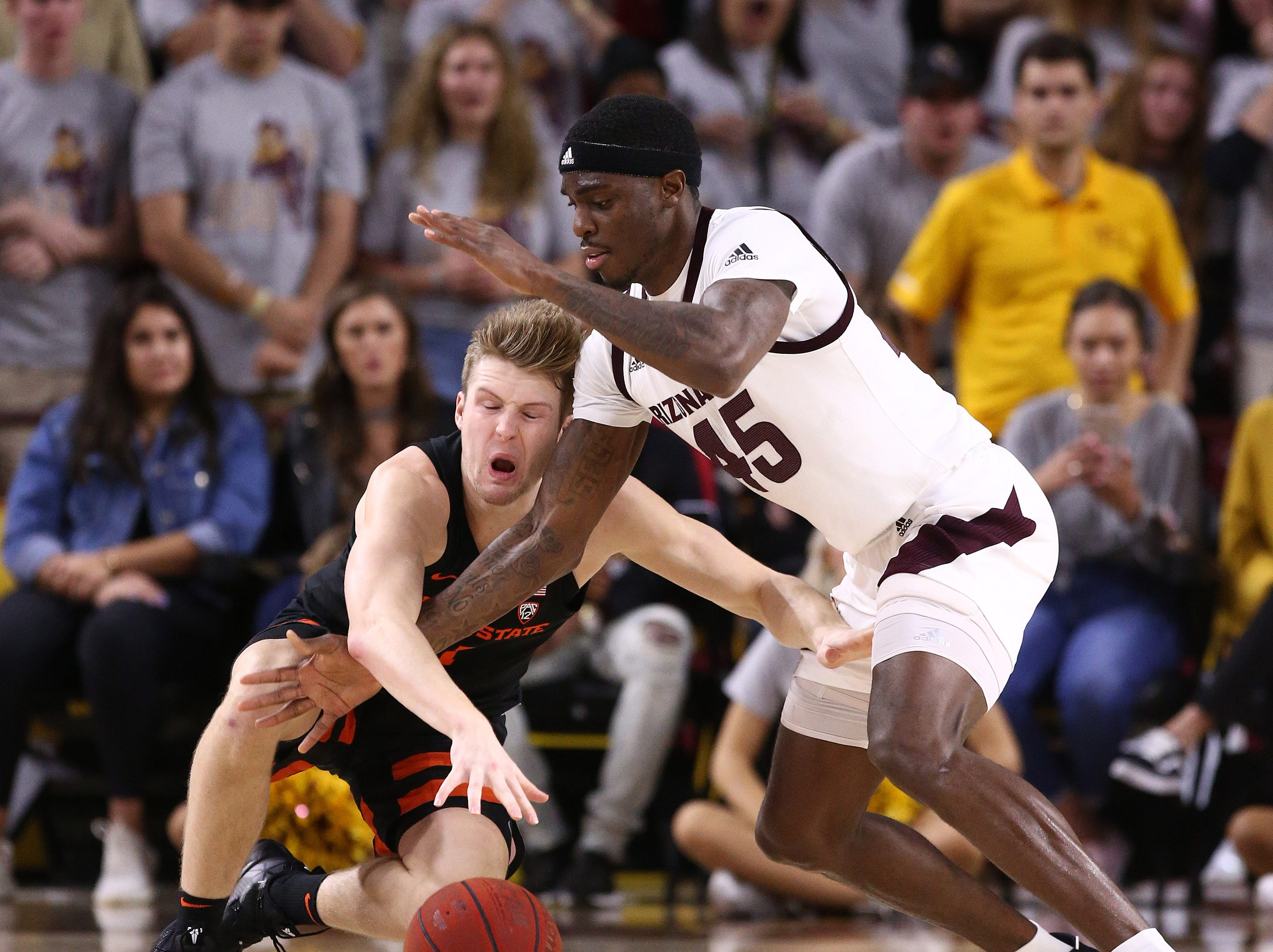 Arizona State Sun Devils forward Zylan Cheatham knocks the ball away from Oregon State Beavers' Zach Reichle in the second half on Jan. 17 at Wells Fargo Arena in Tempe.
