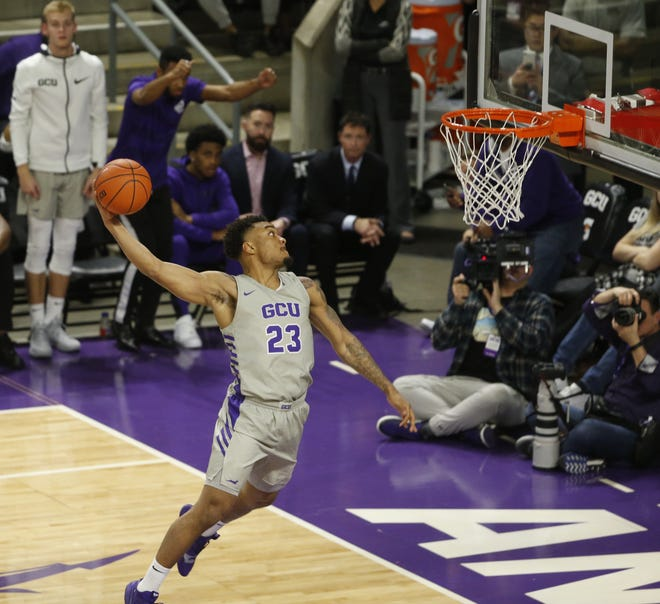 GCU's Carlos Johnson (23) dunks against Chicago State University during the second half at Grand Canyon University Arena in Phoenix, Ariz. on January 17, 2019.