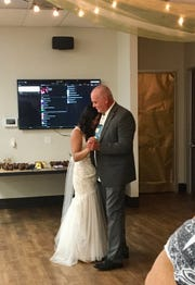 Mimi Refuerzo dances with her father-in-law Dave Armstrong at her wedding reception.