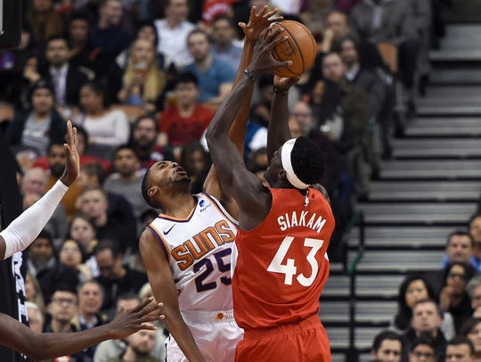 Jan 17, 2019; Toronto, Ontario, CAN; Toronto Raptors forward Pascal Siakam (43) shoots against Phoenix Suns forward Mikal Bridges (25) in the first half at Scotiabank Arena. Mandatory Credit: Dan Hamilton-USA TODAY Sports
