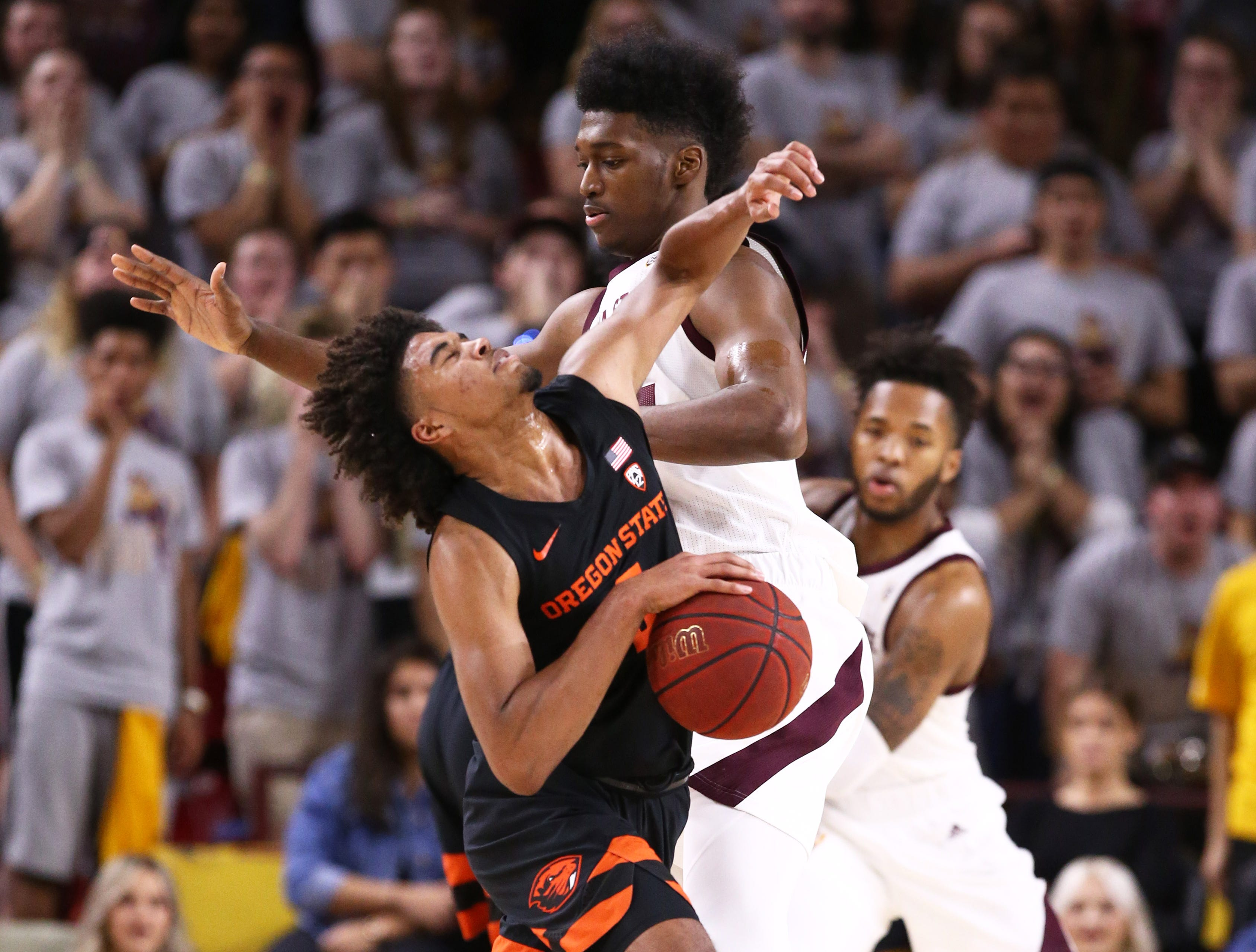 Oregon State Beavers guard Ethan Thompson collides with Arizona State Sun Devils' De'Quon Lake in the second half on Jan. 17 at Wells Fargo Arena in Tempe.