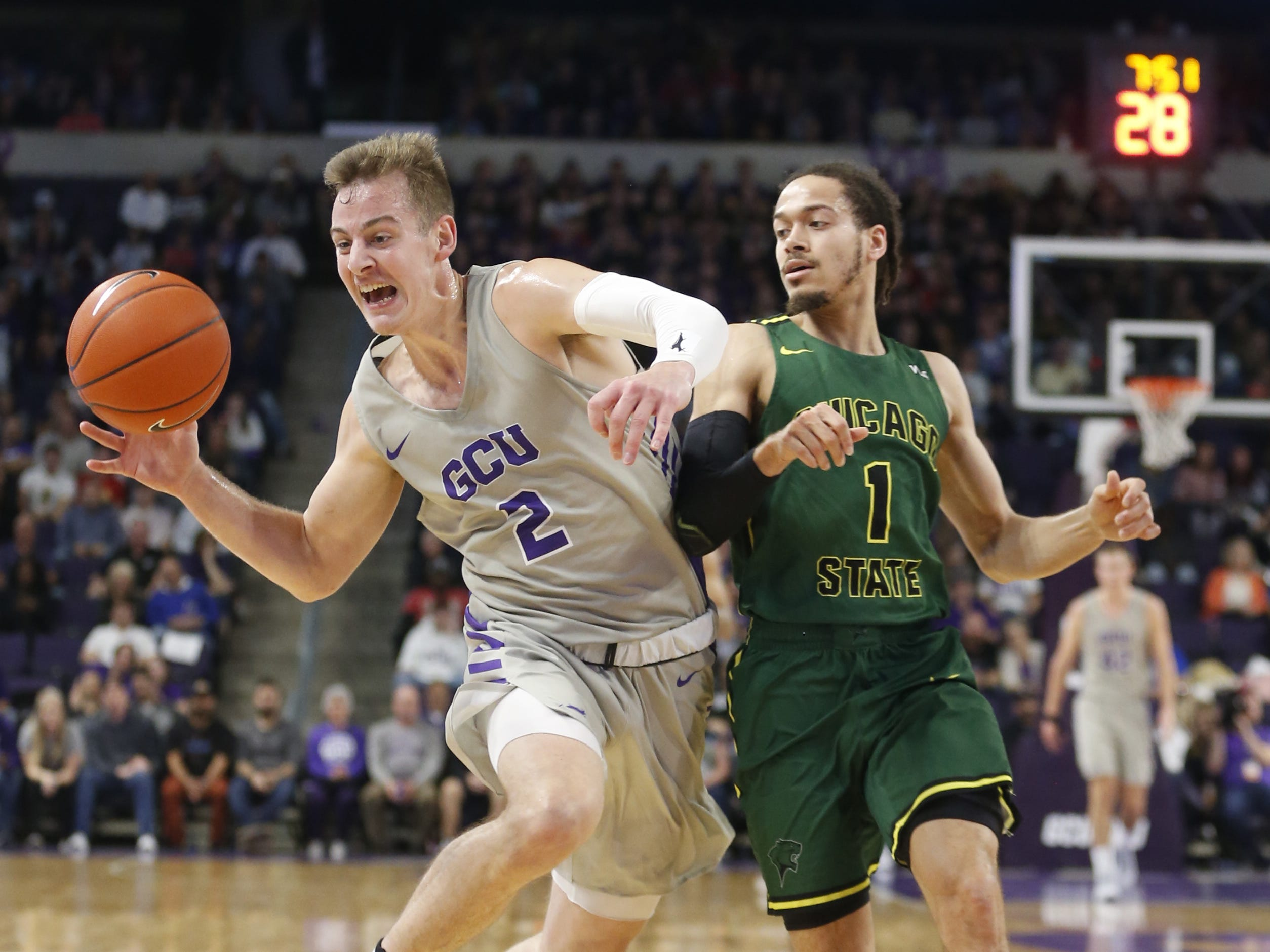 Chicago State University's Rob Shaw (1) forces GCU's Trey Dreschel (2) to lose control of a ball during the first half at Grand Canyon University Arena in Phoenix, Ariz. on January 17, 2019.