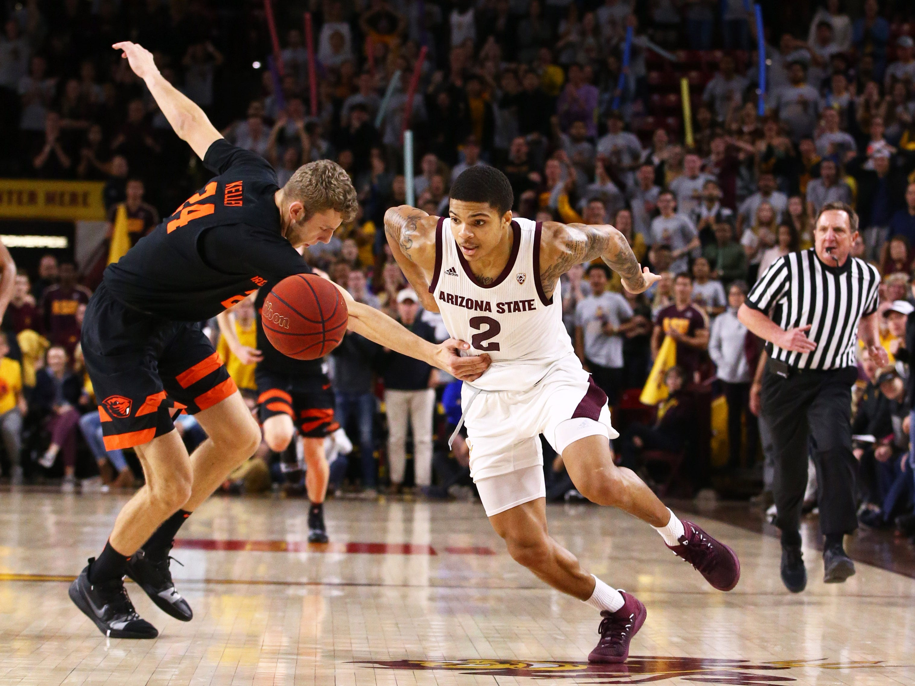 Arizona State Sun Devils guard Rob Edwards is fouled by Oregon State Beavers' Kylor Kelley in the second half on Jan. 17 at Wells Fargo Arena in Tempe.