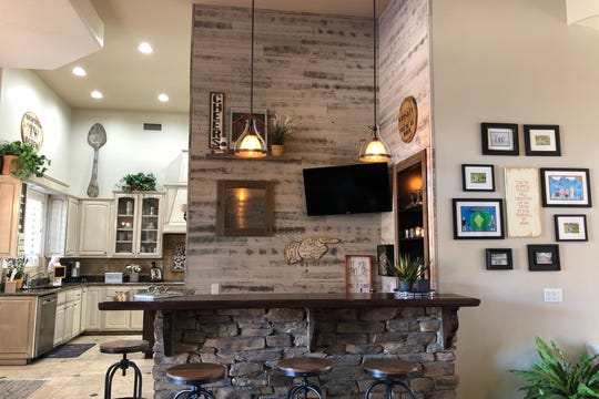 The Revenigs removed a stone arc over the bar top, which opened it up to the living room.