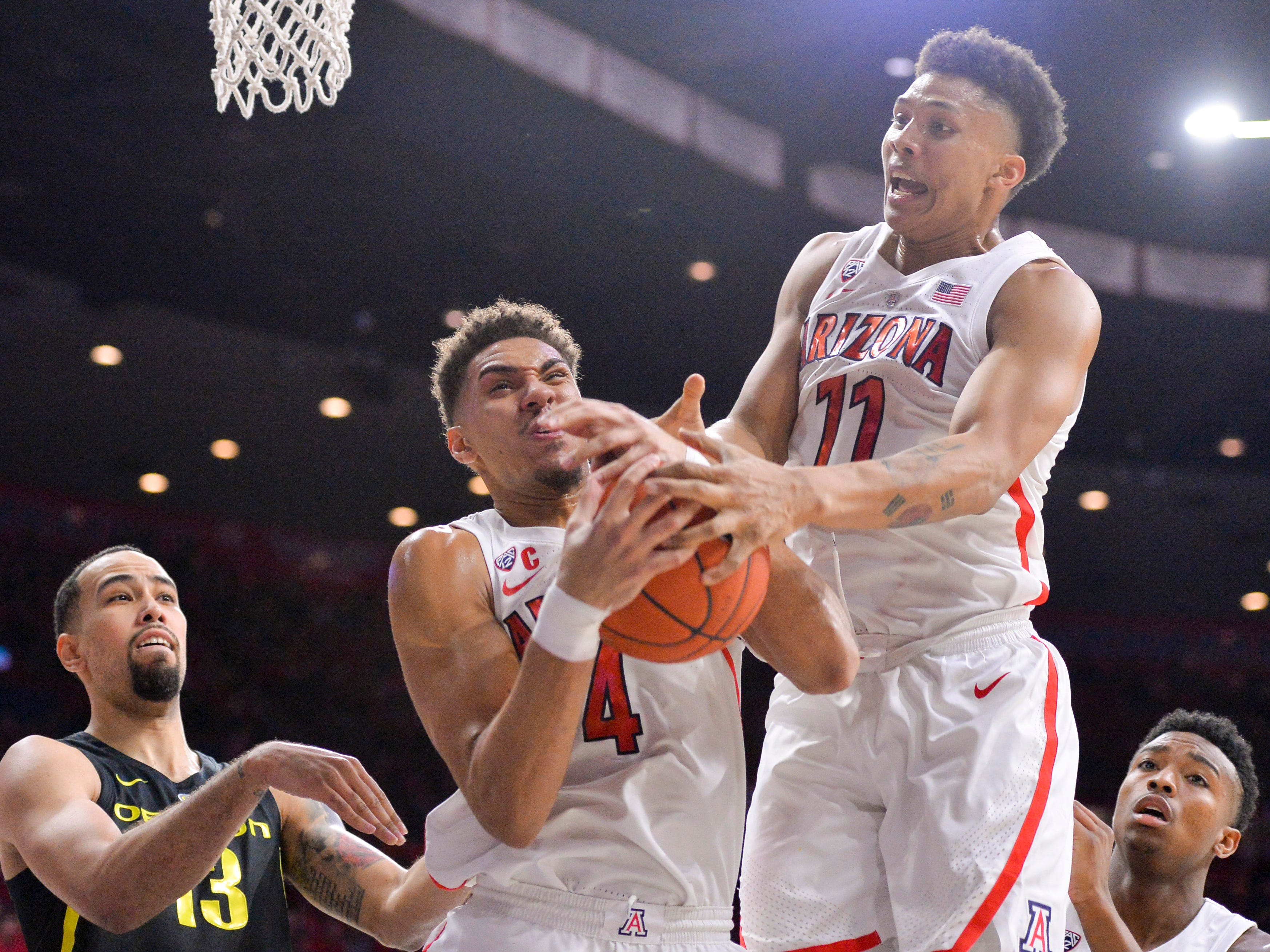 Jan 17, 2019; Tucson, AZ, USA; Arizona Wildcats center Chase Jeter (4) and Wildcats forward Ira Lee (11) battle for a rebound with Oregon Ducks forward Paul White (13) during the first half at McKale Center. Mandatory Credit: Casey Sapio-USA TODAY Sports
