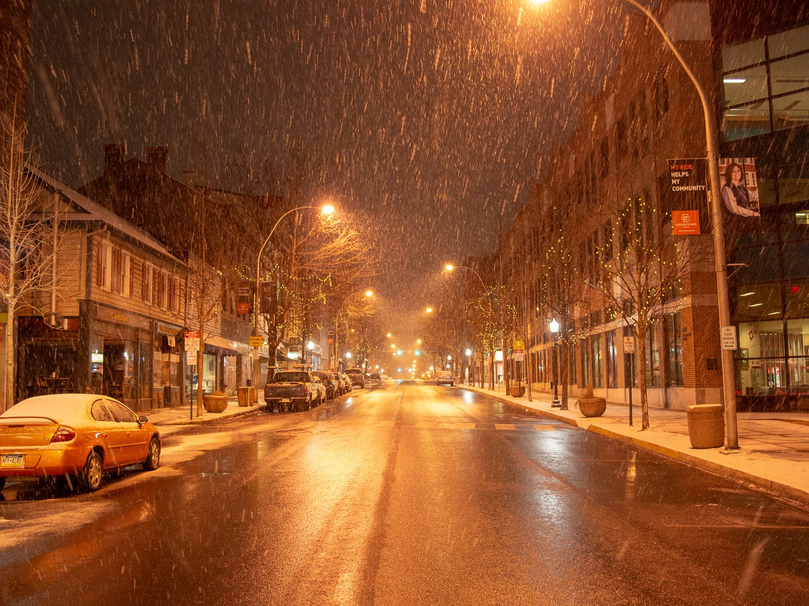 City lights and snow in Lebanon City Thursday evening, Jan. 17. This snow is a prologue of a bigger storm to come over the weekend followed by frigid temperatures.
