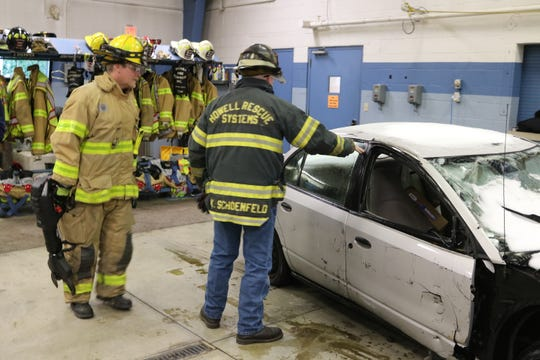 "Kurt Schoenfeld, of Howell Rescue Systems, demonstrates use of the new battery-operated ""jaws of life"" tool at the Harris-Elmore Fire Department on Thursday."