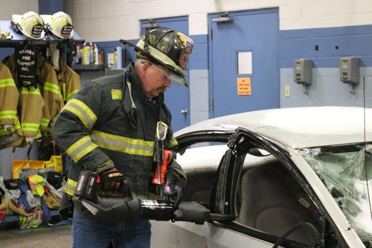 "Kurt Schoenfeld of Howell Rescue Systems demonstrates use of the new battery-operated ""jaws of life"" tool at the Harris-Elmore Fire Department on Thursday."
