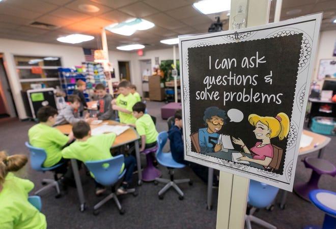 Memphis Elementary School second-graders work on building gumdrop structures Friday, Jan. 18, 2019 in the school's library.