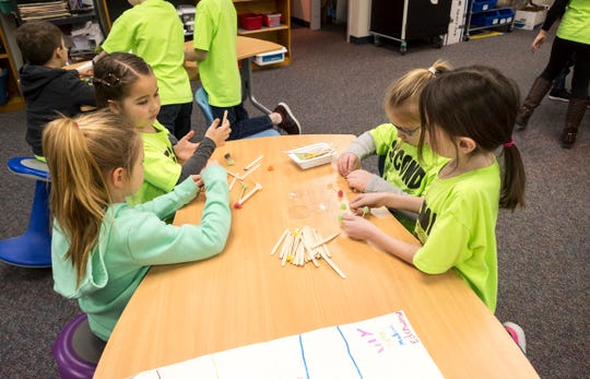 A group of second-graders work on building gumdrop structures Friday, Jan. 18, 2019 in the library at Memphis Elementary School.
