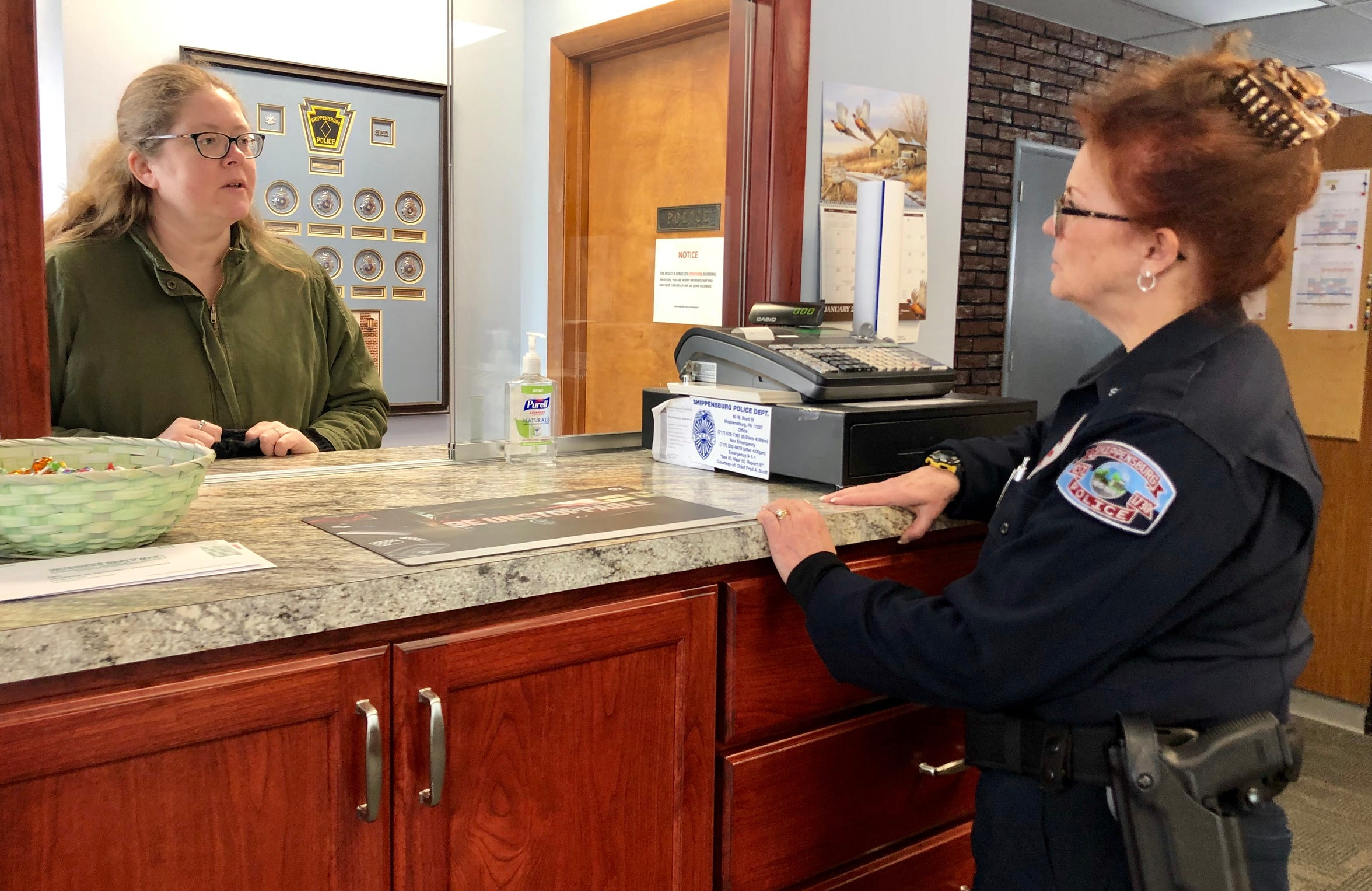 Shippensburg Police Chief Meredith Dominick (right) talks to Stephanie Taylor (left), Vermont, at the station on West Burd Street the morning of Friday, Jan. 18, 2019.