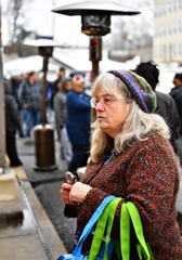 Donna Schmitz, of Dallastown, waits in line during food distribution day at York County Food Bank in York City, Friday, Jan. 18, 2019. Dawn J. Sagert photo