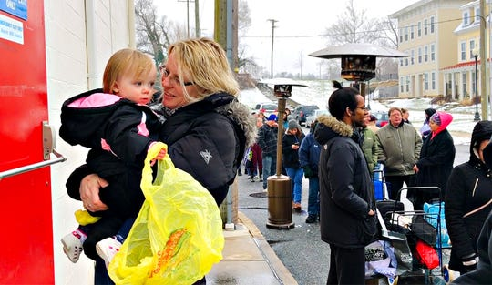 Timi Bond, of Red Lion, holds her 18-month-old granddaughter Illyanna Smith while waiting in line during food distribution day at York County Food Bank in York City, Friday, Jan. 18, 2019. Dawn J. Sagert photo