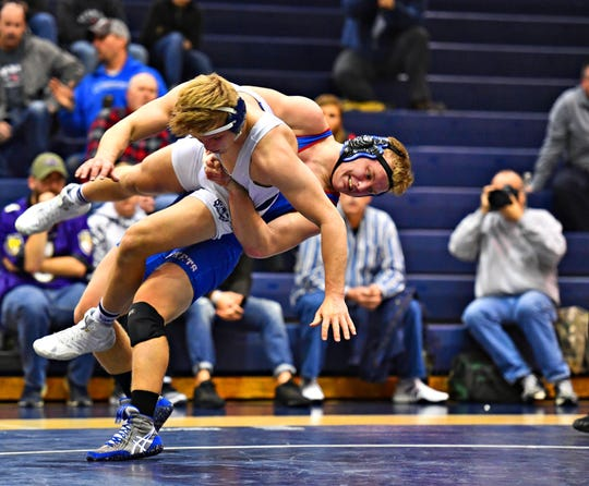 Dallastown's Jarrett Feeney, front, wrestles Spring Grove's Eric Glass in the 195 pound weight class during wrestling action at Dallastown Area High School in York Township, Thursday, Jan. 17, 2019. Feeney would win the match. Dawn J. Sagert photo