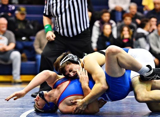 Dallastown's Franklin Klinger, right, wrestles Spring Grove's Camden Rice in the 182 pound weight class during wrestling action at Dallastown Area High School in York Township, Thursday, Jan. 17, 2019. Klinger would win the match. Dawn J. Sagert photo