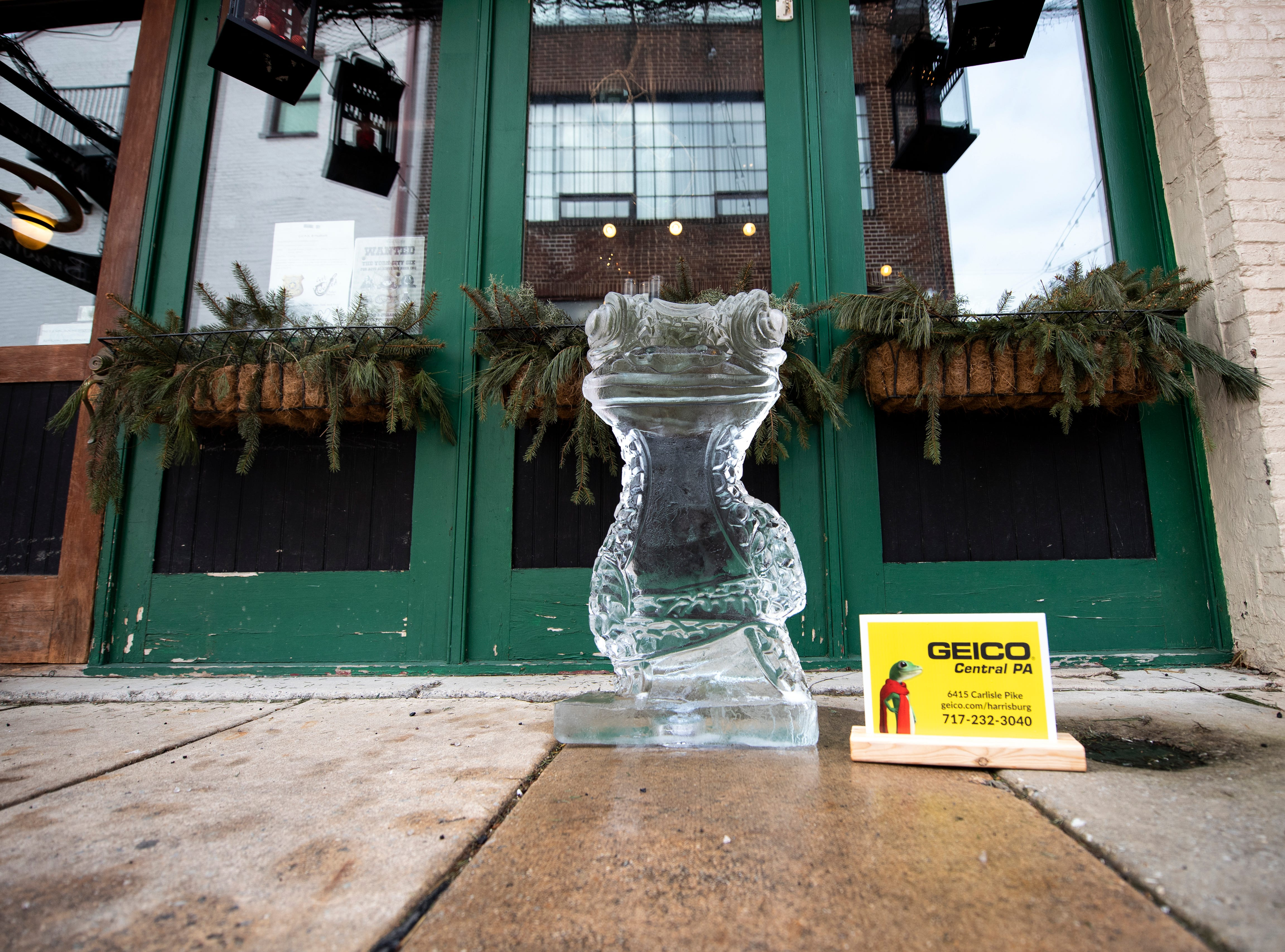 On the streets surrounding Cherry Lane, you'll find many smaller ice sculptures, like this Geico gecko, Friday, Jan. 18, 2019. The FestivICE ice festival has interactive ice sculptures, an ice slide and more. The three-day event ends Saturday.