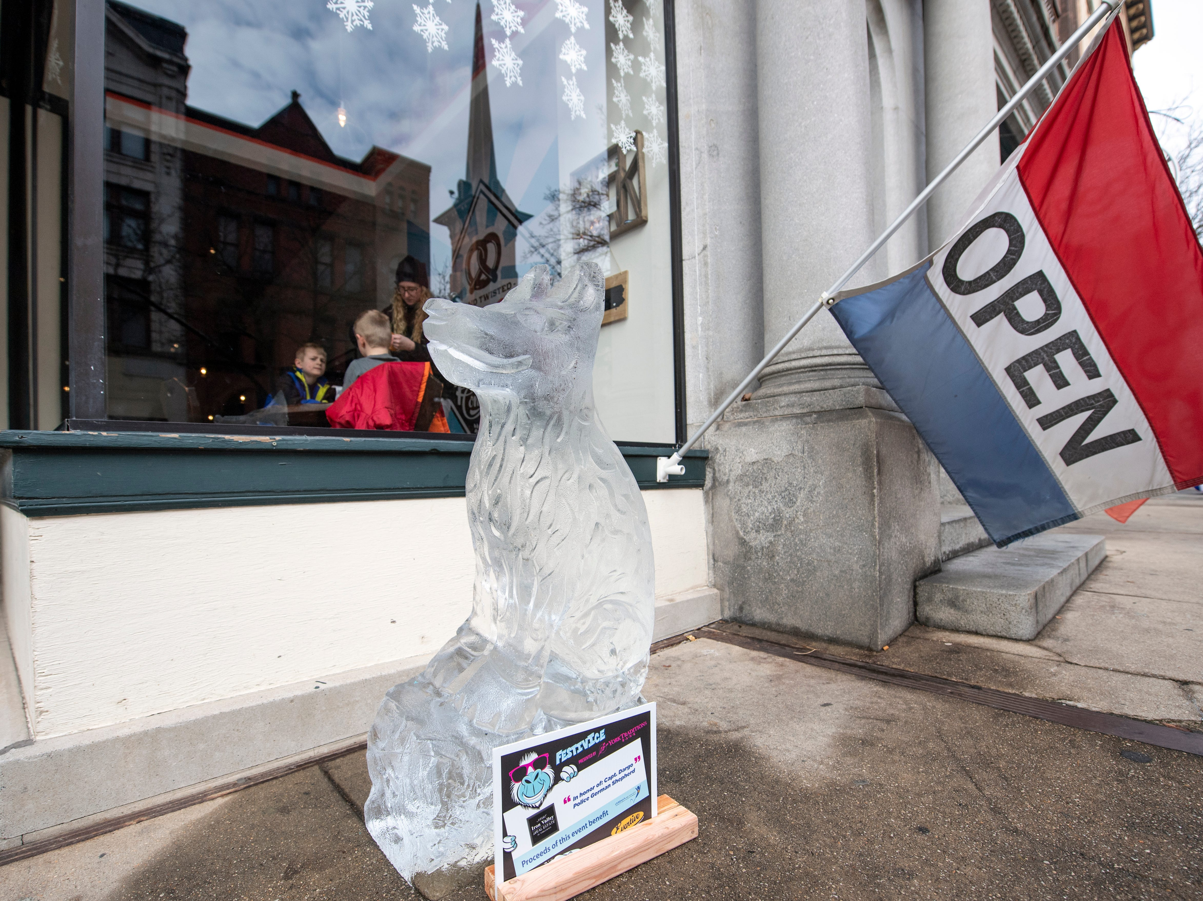An ice sculpture of Drago, the veteran of York County Sheriff's Department's K-9 unit, is one of many ice sculptures downtown, Friday, Jan. 18, 2019. The FestivICE ice festival has interactive ice sculptures, an ice slide and more. The three-day event ends Saturday.