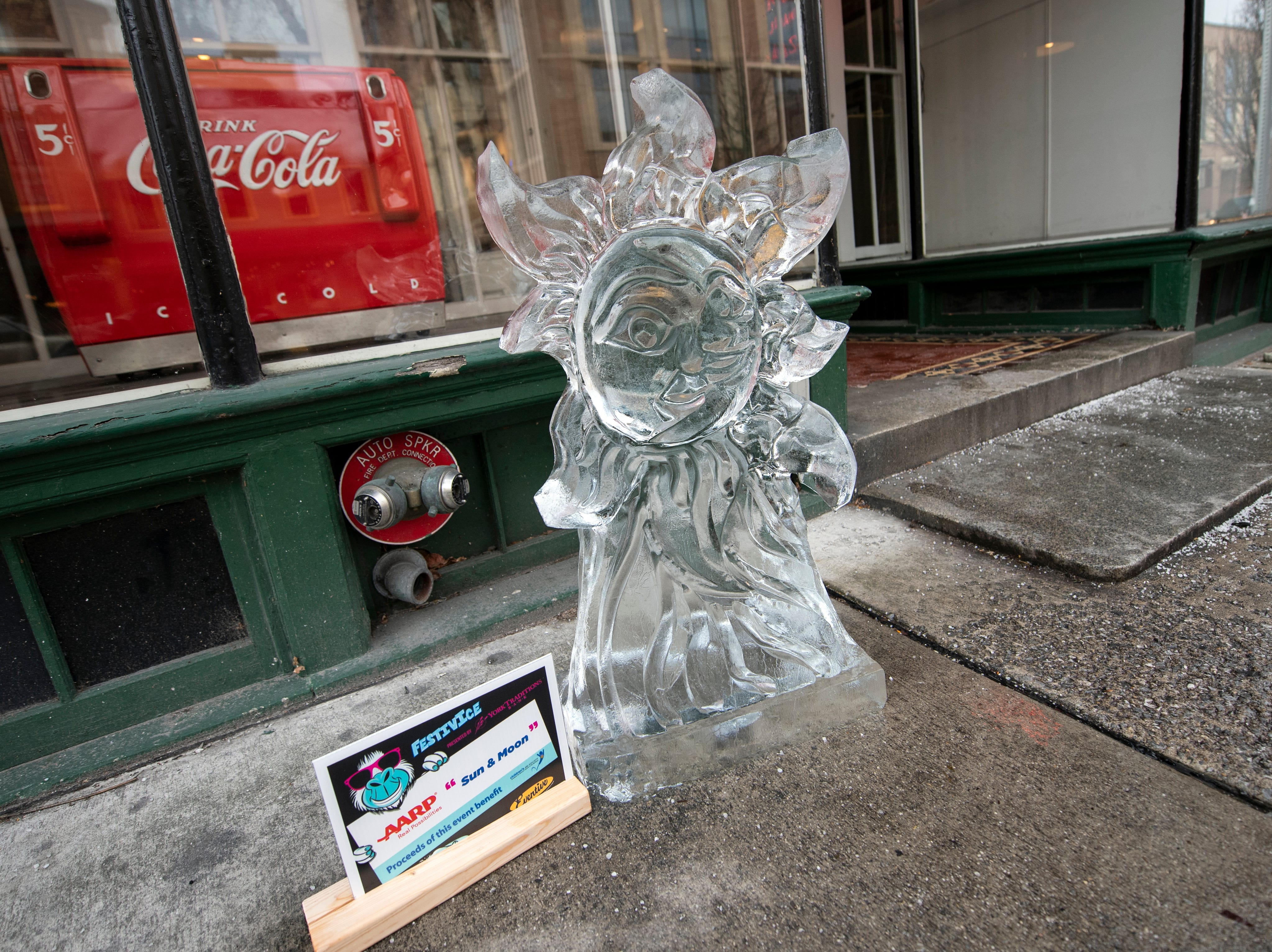 'Sun and Moon' is one of many ice sculptures downtown, Friday, Jan. 18, 2019. The FestivICE ice festival has interactive ice sculptures, an ice slide and more. The three-day event ends Saturday.