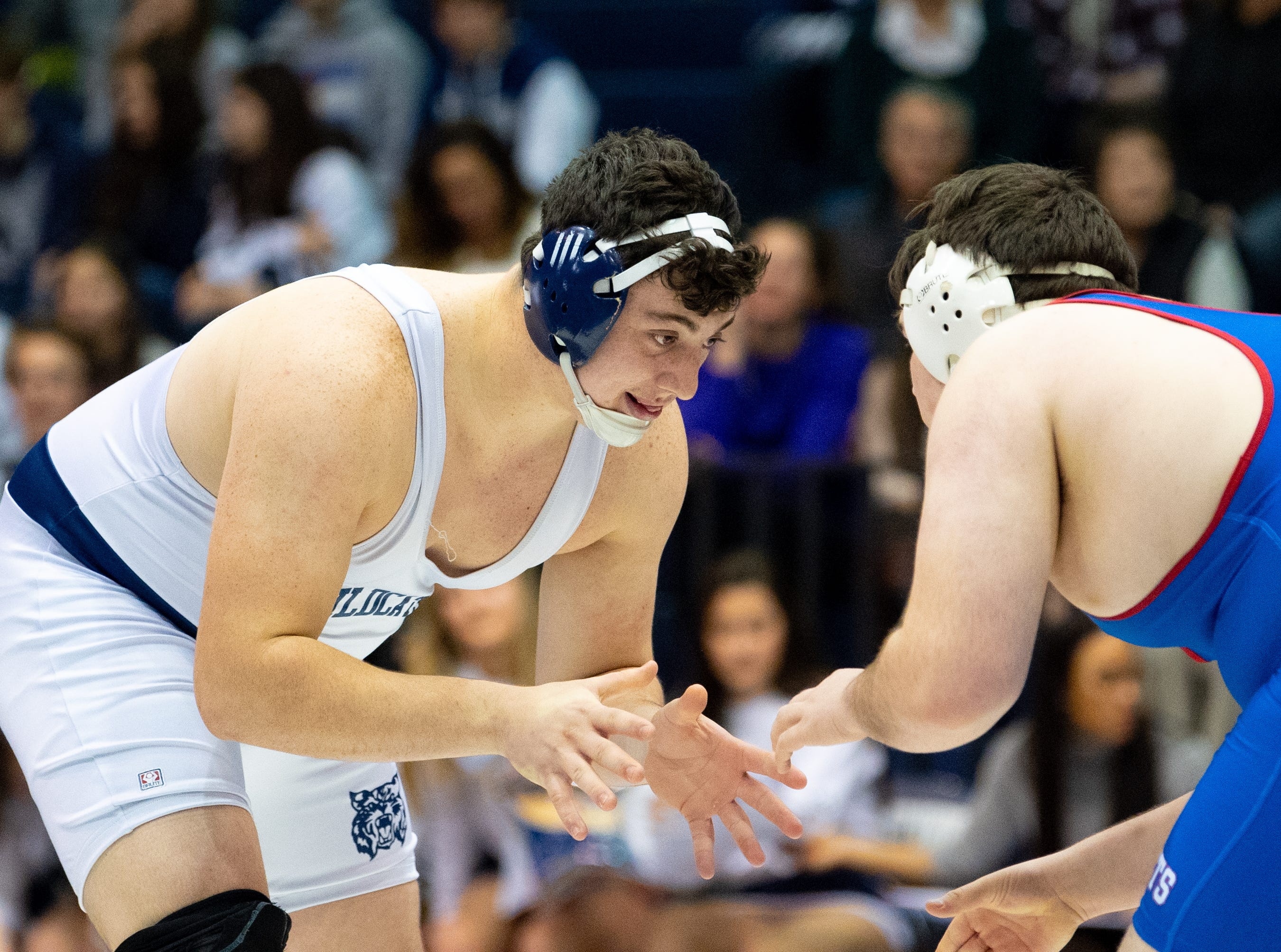 Raymond Christas of Dallastown looks for an opening during the wrestling dual meet between Dallastown and Spring Grove, January 17, 2019. The Wildcats defeated the Rockets 46-24.