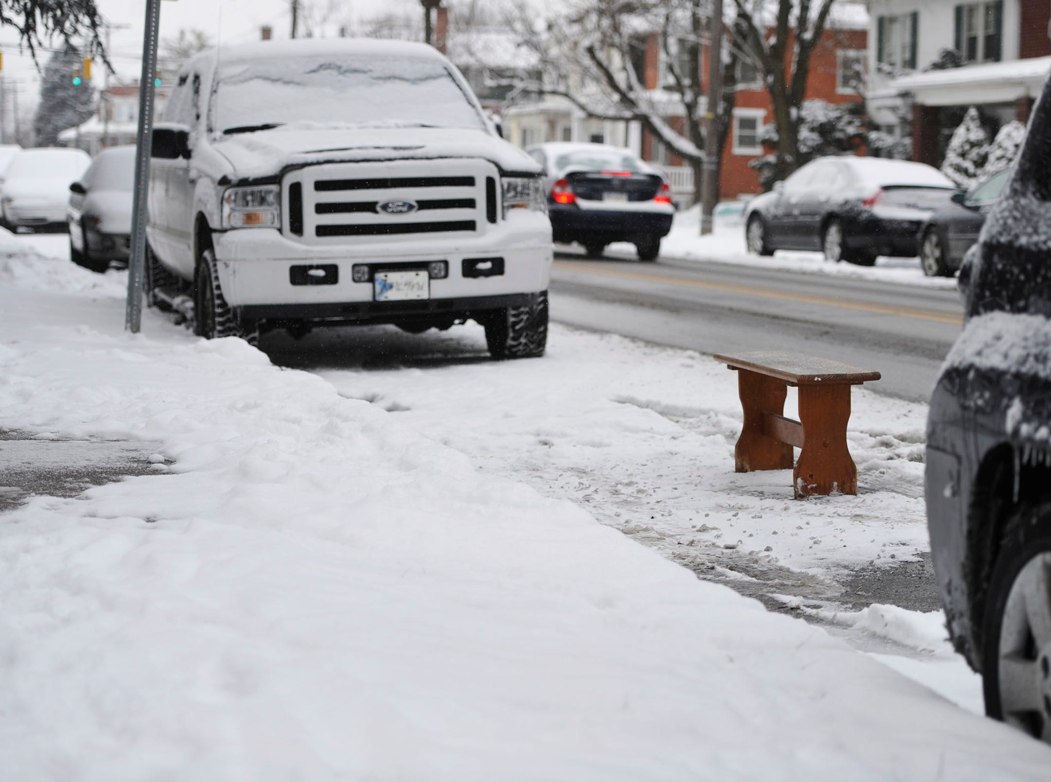 A bench saves a parking space on Roosevelt Avenue in York in 2015.
