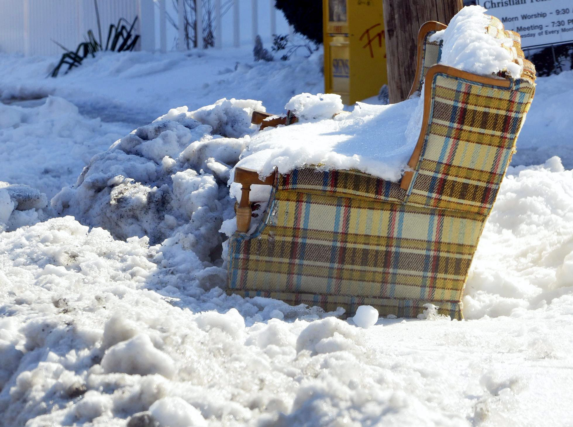 Discarded sofa: Was this a plan to save a as-yet-unshoveled parking space in Chambersburg, or just trash to be picked up?