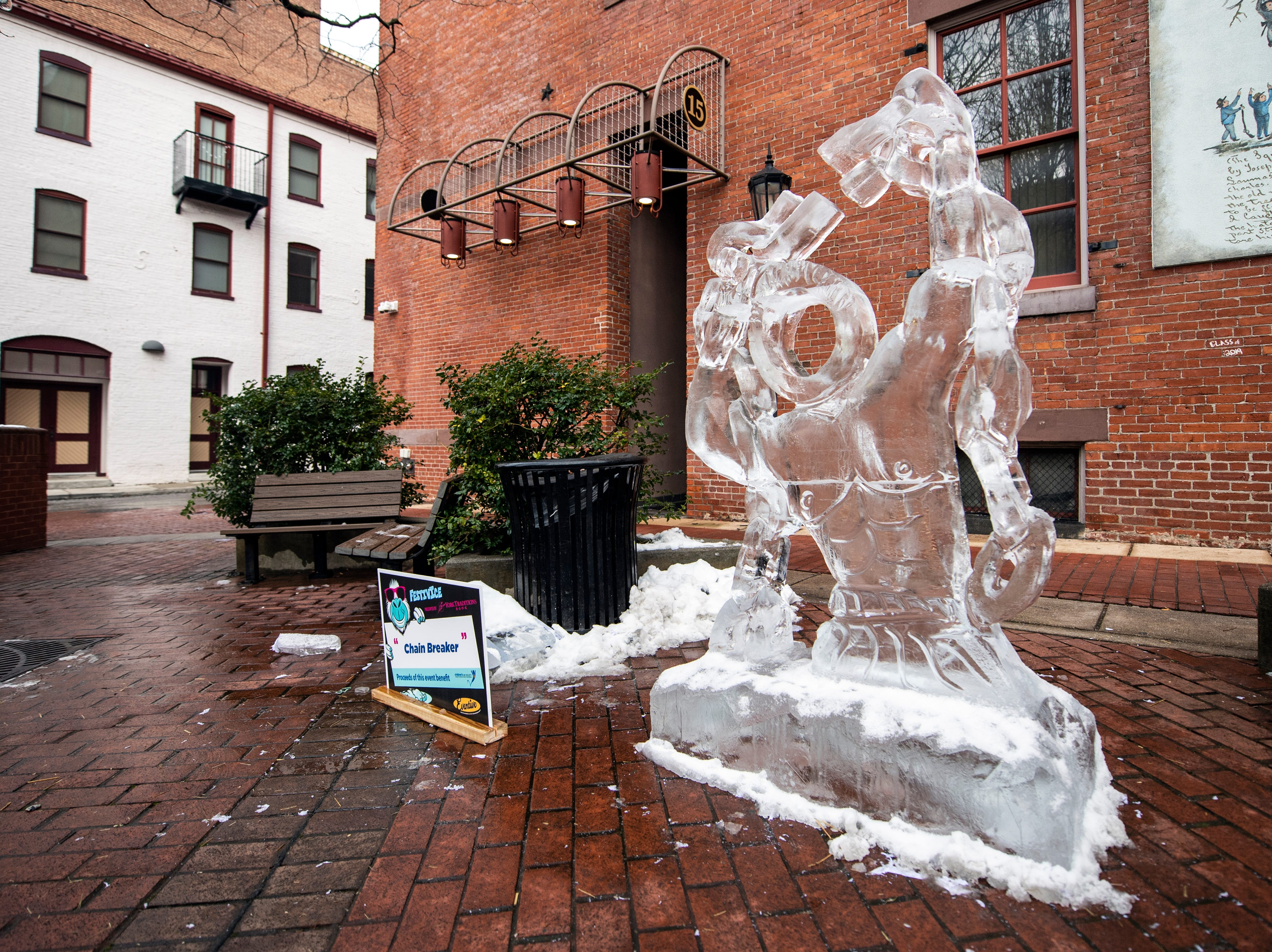 The 'Chain Breaker' ice sculpture is one of many interactive sculptures found in Cherry Lane, downtown, Friday, Jan. 18, 2019. The FestivICE ice festival has interactive ice sculptures, an ice slide and more. The three-day event ends Saturday.