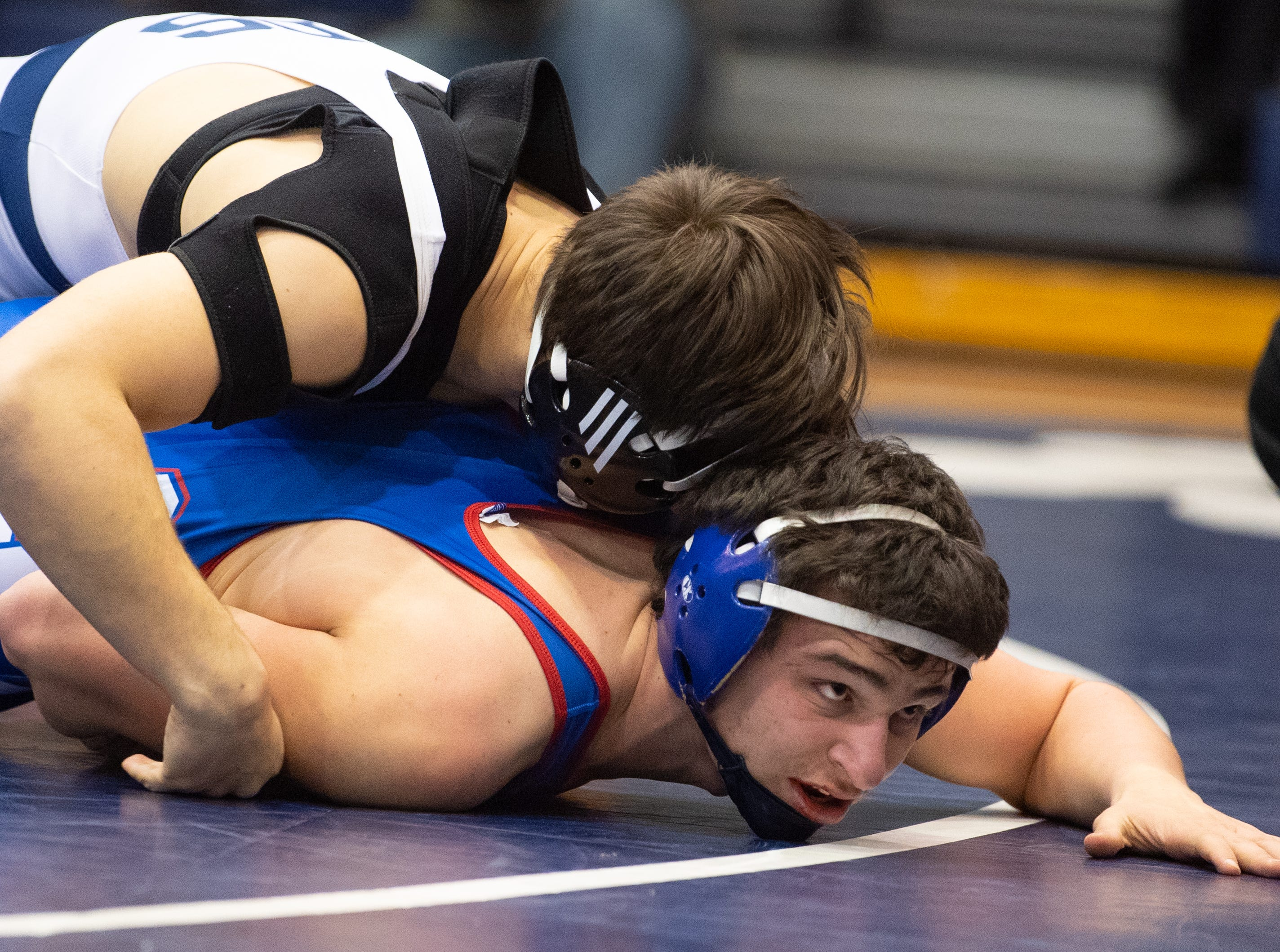 Camden Rice of Spring Grove crawls out of the circle during the wrestling dual meet between Dallastown and Spring Grove at Dallastown Area High School, January 17, 2019. The Wildcats defeated the Rockets 46-24.